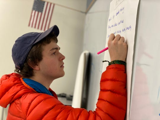 Townes DeGroot, a junior at U-32 Middle & High School in Montpelier, contemplates ways to help his fellow students with issues they face. The school club, Students for Healthy Decisions, is part of the Getting to Y program, a initiative where students analyze their Youth Risk Behavior Survey data and implement possible solutions to problem areas.