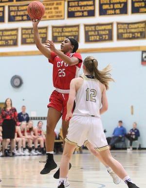 CVU's Mekkena Boyd shoots during Tuesday's high school girls basketball game at Essex.