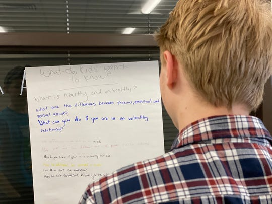 """Cole Heigis, a junior at U-32 Middle & High School, looks at a list his peers have compiled about how to address dating violence in their school population. Heigis is part of the schools """"Students for  Healthy Decisions"""" club, the school's implementation of the Getting to Y program."""