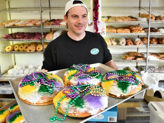 Stephen Simon, owner of JB Bakery in Burlington, prepares King Cakes and Fasnacht Donuts for Mardi Gras celebrations this month.