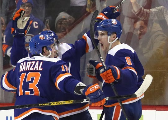 Ryan Pulock, right, gave the Islanders the lead with 40 seconds left in the third period. The Flyers had erased a three-goal deficit to tie the game on the previous shift.