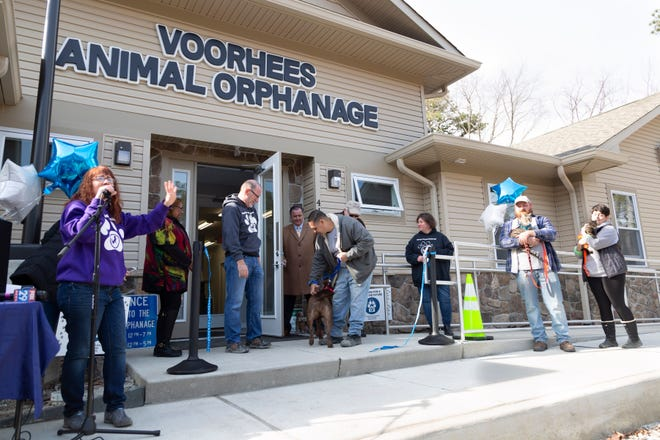 Jennifer Bailey, marketing manager at Voorhees Animal Orphanage, takes the microphone at to invite visitors inside the newly renovated facility.