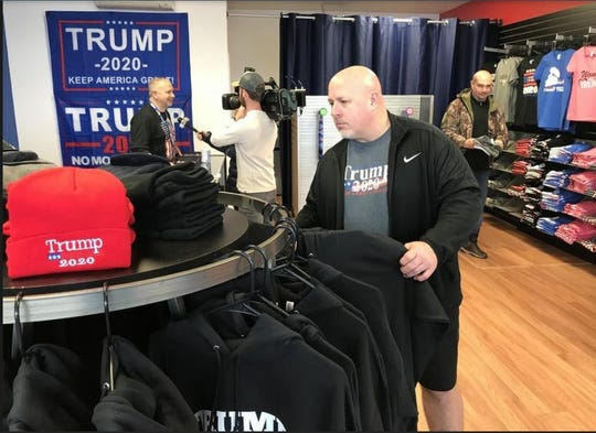Jeff Rhodes of Levittown, Pennsylvania, browses the hoodie selection at the Trump Store in Bensalem.