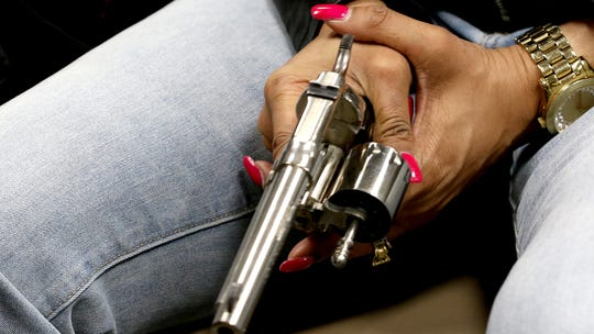 Nearly 200 women come to this Ohio church basement to conquer fears and fire guns