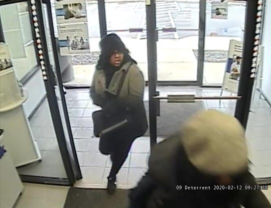 Cincinnati police say this woman helped a man rob a West Side bank this morning.