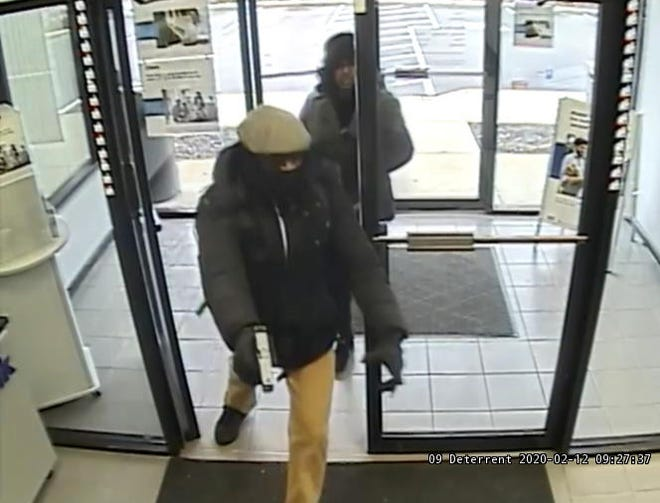 Cincinnati police say this man and woman robbed a West Side bank this morning.