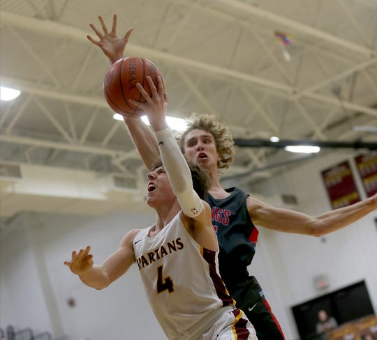 Turpin's  Dominic Cantrella (4) drives to the basket against Kings Knights player PJ Marchal (5) during their basketball game, Tuesday, Feb. 11, 2020.