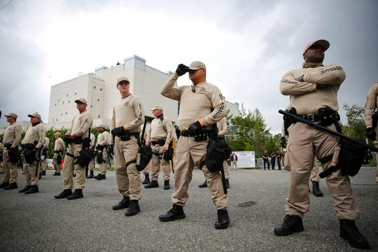 In this Oct. 19, 2017 photo, Troopers with the Florida Highway Patrol Quick Response Force line in front of the Phillips Center on the University of Florida campus in Gainesville, Fla.,  ahead of white nationalist Richard Spencer's speech,  White supremacist propaganda circulated on college campuses nearly doubled in 2019, according to a report by the Anti-Defamation League published Wednesday, Feb. 12, 2020.