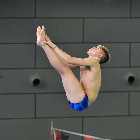 Nathan Cox took home a 2nd place medal for Mariemont in the boys diving finals at the 2020 Southwest Ohio Swimming and Diving Classic, January 19, 2020.