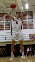 Turpin's Harry  Tyszkiewicz (5) shoots the ball during their basketball game, Tuesday, Feb. 11. 2020.