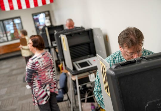 Montgomery County residents cast their ballot on the first day of early voting at the Election Commission in Clarksville, Tenn., on Wednesday, Feb. 12, 2020.