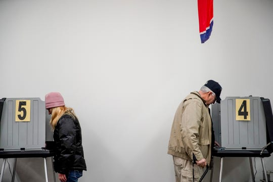 Montgomery County residents stand back to back and cast their ballots on the first day of early voting at the Montgomery Election Commission in Clarksville, Tenn., on Wednesday, Feb. 12, 2020.
