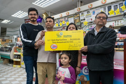 A representative of the New Jersey Lottery presented Quick Stop Food Store owners Apexaben and Kauschik Patel with a $ 30,000 check to sell the winning Mega Millions jackpot ticket from the February 11 draw.