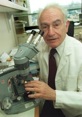 Dr. Norman Ende, a 95-year-old pathology professor at Rutgers New Jersey Medical School in Newark, has filed an age-discrimination lawsuit against the university, its medical school and its dean. He is pictured in 1991 at the former University of Medicine and Dentistry of New Jersey.