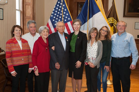 Hunterdon County Veteran John Paller was presented with France's highest award, the National Order of the Legion of Honor, for his service in combat during World War II. With Paller (fourth from left) is Anne de Broca-Hoppenot, Honorary Consul of France (NJ), David Paller (son), Diana Paller (wife), Consul General Anne-Claire Legendre, Virginia Dean (daughter), Megan Dean Farah (granddaughter) and Michael Dean (son-in-law).