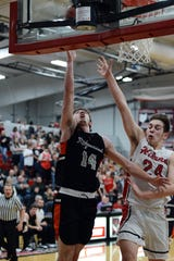 Dalton Patterson goes in for a layup during Ridgewood's 55-46 loss against host Hiland on Tuesday night in Berlin.
