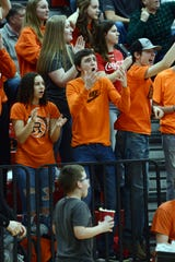 Ridgewood fans react to a call during a 55-46 loss to host Hiland on Tuesday night in Berlin.