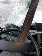 A photo provided by Johnnie Lowe shows his work truck after a beam slammed through his windshield about 1:30 p.m. Thursday, Feb. 6, 2020, as he drove westbound on I-96 near Williamston.
