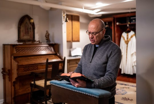 Father Eduard Perrone does his morning prayer last week. Perrone is a popular Catholic priest who was suspended last summer for alleged child sex abuse. His parishioners have filed a lawsuit to get him back, saying a rape claim was fabricated against him and that he deserves to be back in church.