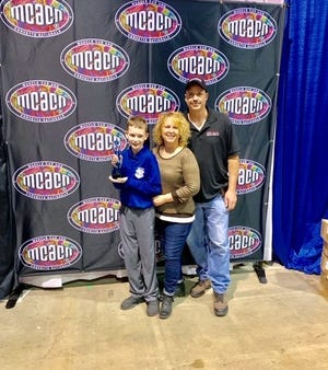 Keegan, Hillary and Roman Sobilo on Nov. 23, 2019, at the Muscle Car and Corvette Nationals in Rosemont, Illinois.