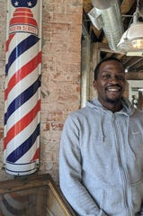 Detroit barber Willie Graham Jr., 42, said he plans to support former New York Mayor Michael Bloomberg in Michigan's Democratic Presidential Primary Election March 10.