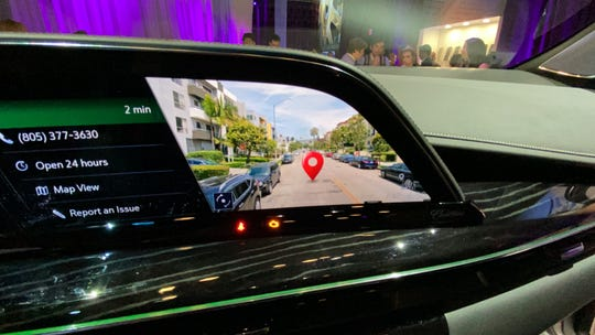 The 2021 Cadillac Escalade's augmented reality navigation system features incredibly high resolution street view video.