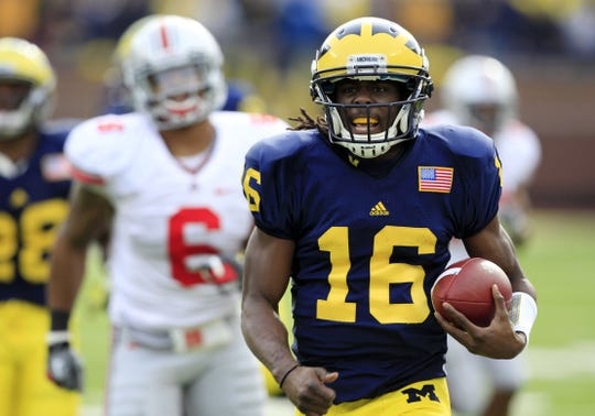 Michigan quarterback Denard Robinson runs for a 41-yard touchdown during the first quarter of the win over Ohio State on Saturday, Nov. 26, 2011, at Michigan Stadium.