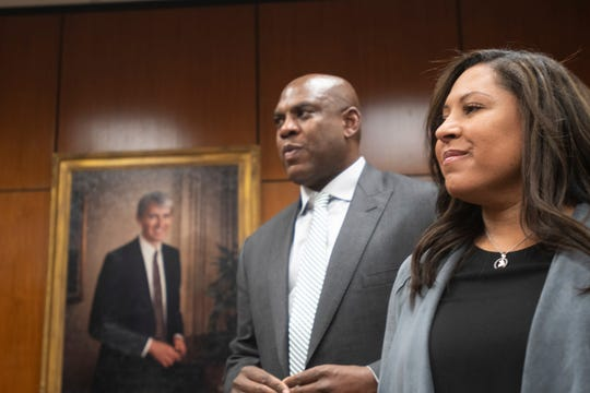 New Michigan State football coach Mel Tucker and wife Jo-Ellyn stand as the Board of Trustees and others applaud his new position as head coach Wednesday, Feb. 12, 2020, the Hannah Administration Building in East Lansing,.