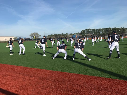 The Detroit Tigers pitchers stretch before working out in spring training on Tuesday, Feb. 12, 2020, in Lakeland, Florida.