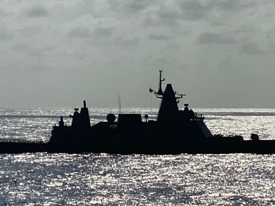 A Thai warship near the Westerdam cruise ship, which has been stuck at sea as countries deny it a port to dock.