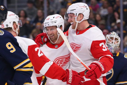 Red Wings forward Darren Helm (43) celebrates his second goal of the game with forward Anthony Mantha (39) during the second period  Tuesday in Buffalo, New York.