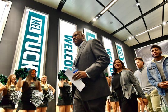 Mel Tucker arrives for his press conference at the Breslin Center on Wednesday night.