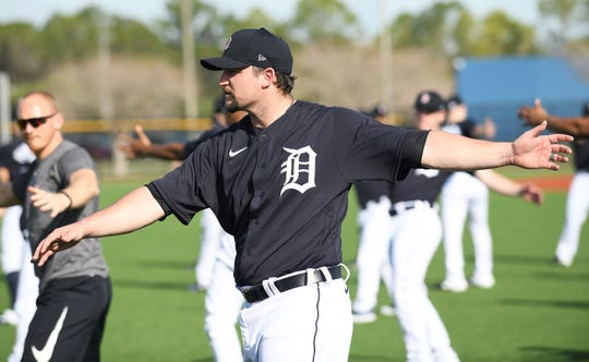Tigers non-roster invitee Zack Godley stretches at the first day of Tigers spring training Wednesday in Lakeland, Florida.