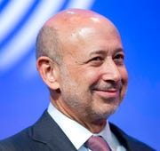 In this Sept. 24, 2014, file photo Lloyd Blankfein, Chairman and CEO of Goldman Sachs, speaks in a panel discussion at the Clinton Global Initiative in New York.