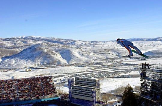 Simon Ammann, of Switzerland, competes in the men's K90 Individual ski jump at the 2002 Salt Lake City Winter Olympics in Park City, Utah on Feb. 10, 2002.