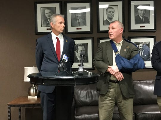 Rep. John Reilly, R-Oakland Township, and Mark Gerhard speak at a press conference Tuesday, Feb. 11, 2020 in Lansing. Reilly is introducing legislation to more narrowly define a terrorist threat after Gerhard's son was charged with the crime over a Snapchat post.