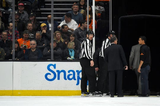 Officials leave the ice after the game between the Anaheim Ducks and the St. Louis Blues was postponed following a medical emergency involving Blues defenseman Jay Bouwmeester during the first period Tuesday.