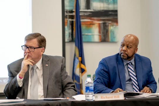 Board of Education Vice President Richard Hill (left) and Secretary James Avery listen to other members of the board on Tuesday, Feb. 11, 2020 during the Genesee Intermediate School District board meeting at the Genesee Intermediate School District in Flint.