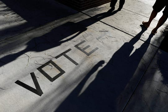 FILE - In this Nov. 6, 2018 file photo, voters head to the polls at the Enterprise Library in Las Vegas.