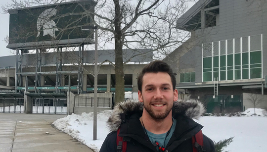 Michigan State University student Ben Alexander is pictured on campus on  Wednesday, Feb. 12, the day the university hired a new football coach, Mel Tucker.
