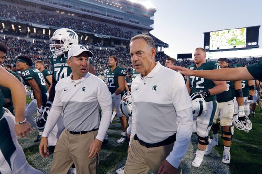 Having Mike Tressel, left, succeed the retired Mark Dantonio for a season would help calm MSU's football program, Wojo writes.