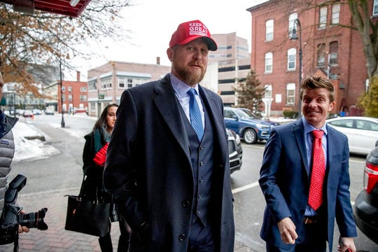 """Brad Parscale, campaign manager for President Donald Trump, center, wears a red had that reads """"Keep N.H. Great"""" as he arrives to speak on SiriusXM Satellite Radio at the Red Arrow Diner, Tuesday, Feb. 11, 2020, in Manchester, N.H."""