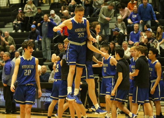 Horseheads players celebrate their 75-64 win over Corning in boys basketball Feb. 11, 2020 at Corning-Painted Post High School.