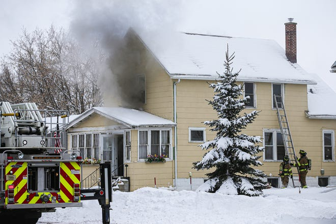 Firefighters battle a house fire Tuesday, February 11, 2020 in the 500 block of Maine Avenue in North Fond du Lac, Wis.