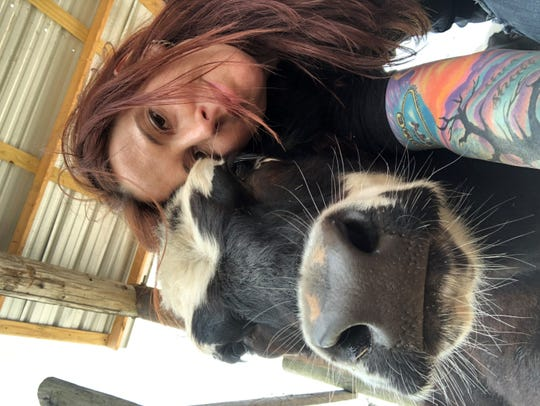 If Amy Dimon had won the Inked magazine contest, she said she would have used part of the money to start a sanctuary for dogs, cats and even farm animals.