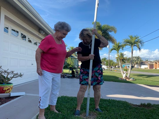 A Cape Coral code enforcement officer had Peggy Sakowski and her neighbor Joyce Kendall seeing red ... and white and blue ... over a 20-year-old flagpole.