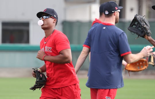 Jeter Downs, outfielder, blows a bubble  as he practices Wednesday morning. Spring training in Southwest Florida has officially begun. Pitchers and Catcher as well as a few other players for the Red Sox have reported in Fort Myers, FL. Red Sox fans gathered to try and get an autograph from their favorite players.