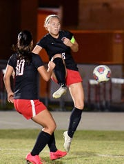 North Fort Myers High School Emilee Hauser (18) takes a shot at the goal during their game with Barron Collier High School in the Class 5A regional quarterfinal girls soccer game. North Fort Myers, Tuesday, Feb.11, 2020. (Photo/Chris Tilley)