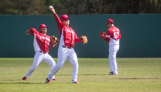 Players warm up during a practice for the Kia Tigers, a South Korean professional baseball team. The team is spending Spring Training training at Terry Park in Fort Myers.