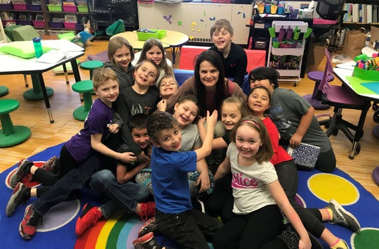 Jaime Robinson, shown with her second-grade class at Algoma Elementary School, is one of two Kewaunee County educators named a Teacher of Distinction by the Greater Green Bay Chamber, part of the process toward earning a Golden Apple Award.